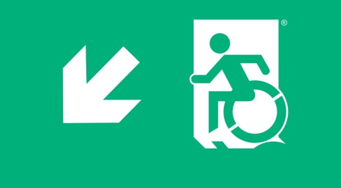 White on New Green Wheelie Man Wheelchair Exit Sign Egress Group